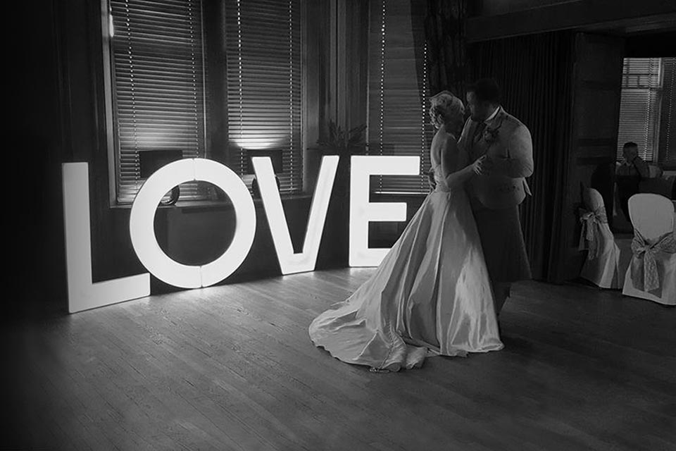 Giant Light Up Letters spelling love, hired along with one of our Photo Booths