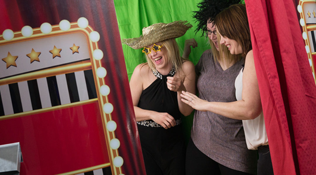 Picture demonstrates people using a Photo Booth in a Blog about which Booth to choose for their event.
