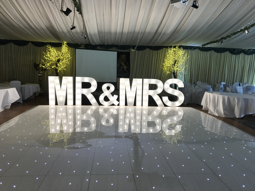 White Chair Covers as part of venue decoration for a Wedding