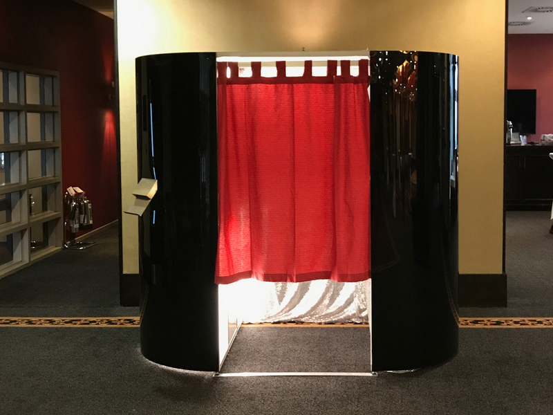 Corporate Events booking for the Black Gloss Photo Booth with Silver Curtain inside