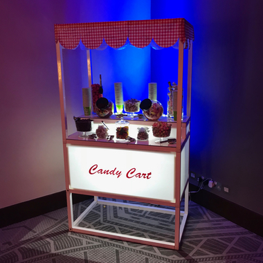 Modern Candy Cart Fully Stocked for the guests of the Wedding.