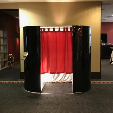 Photo Booth with Black Gloss Skin, internal Champagne Curtain and Red Doorway Curtain