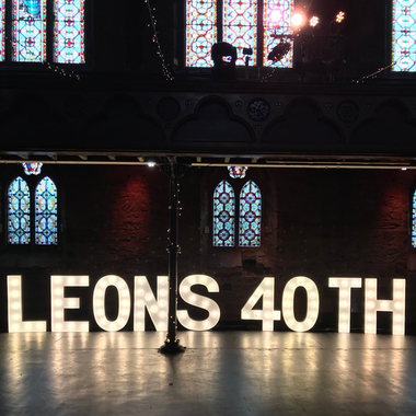 Giant Light Up Letters spelling the name Leon for a 40th Birthday Party