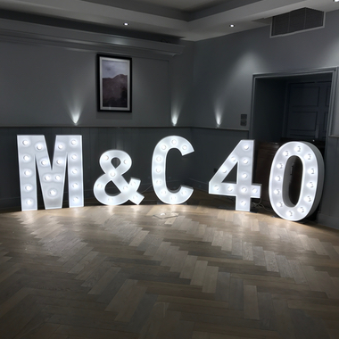Giant Light Up Letters spelling M&C 40 for a joint Birthday Party in Glasgow