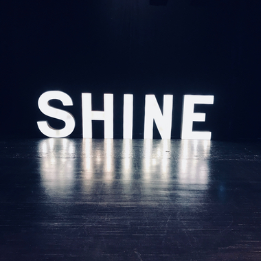 Giant Light Up Letters spelling the word Shine for a Dance exhibition