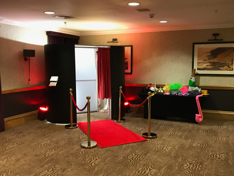 Black Matt Party Photo Booth with Gold VIP Poles, Red Ropes and Red Carpet