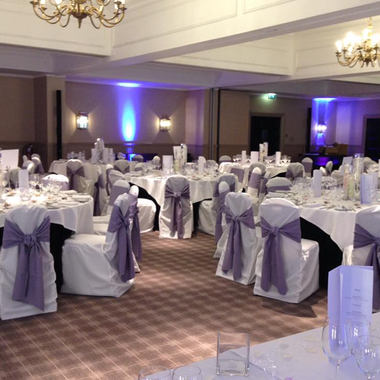 Chair Covers with Ties as part of Venue Decoration for a Wedding