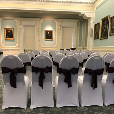 White Chair Covers with Tartan Ties set up for a Wedding