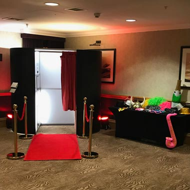 Black VIP Party Photo Booth with Red Carpet and Gold Poles with Red Ropes