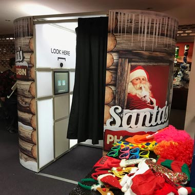 Photo Booth with a Santa Cabin Skin