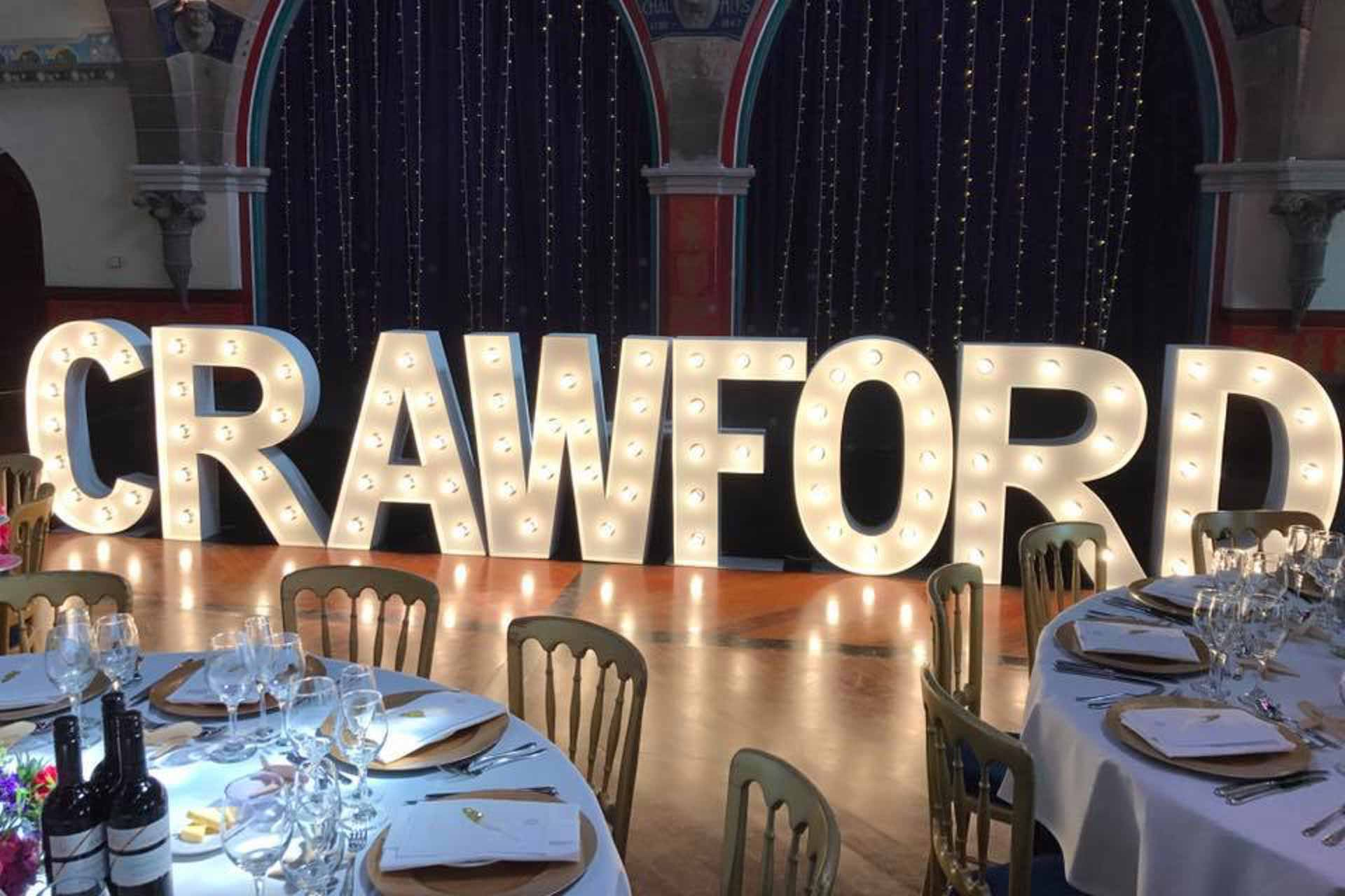 4ft Giant Light Up Letters spelling out the new married couples name booked with one of our Photo Booths