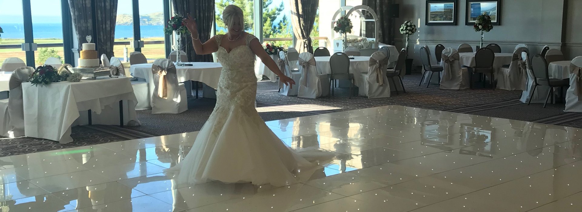 Bride Dancing on one of our 20ft x 20ft White LED Dance Floors