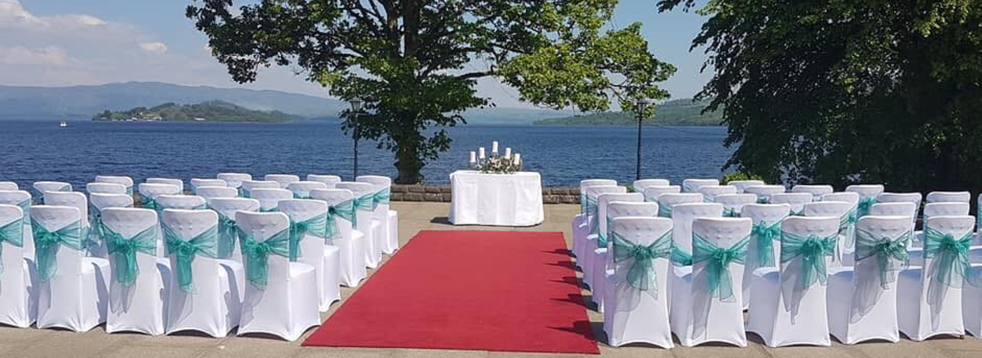 Chair Covers and Venue Decoration outside at The Cruin in Loch Lomond