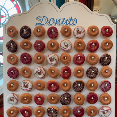 Donut Wall to accompany a Candy Cart stocked full of sweets.
