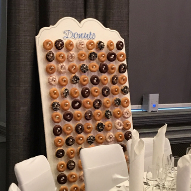 6ft Donut Wall accompanied by a Wooden Candy Cart