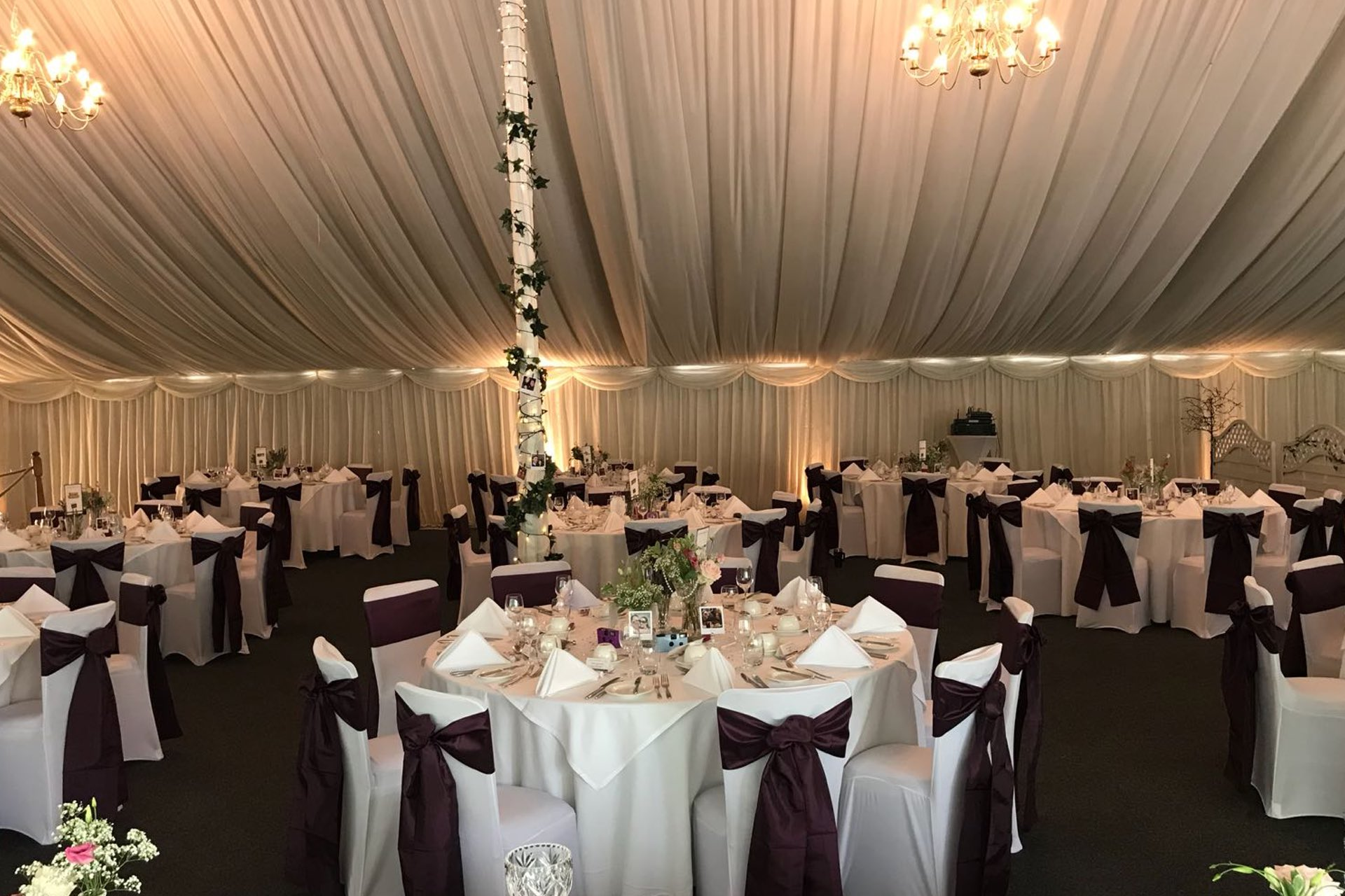 White Chair Covers and Purple Sashes Slider