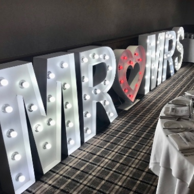 Giant Light Up Mr & Mrs letters with a red heart in the middle