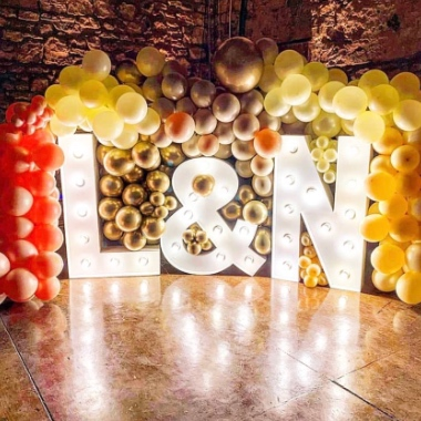 Light Up Initials surrounded with balloons to celebrate an engagement